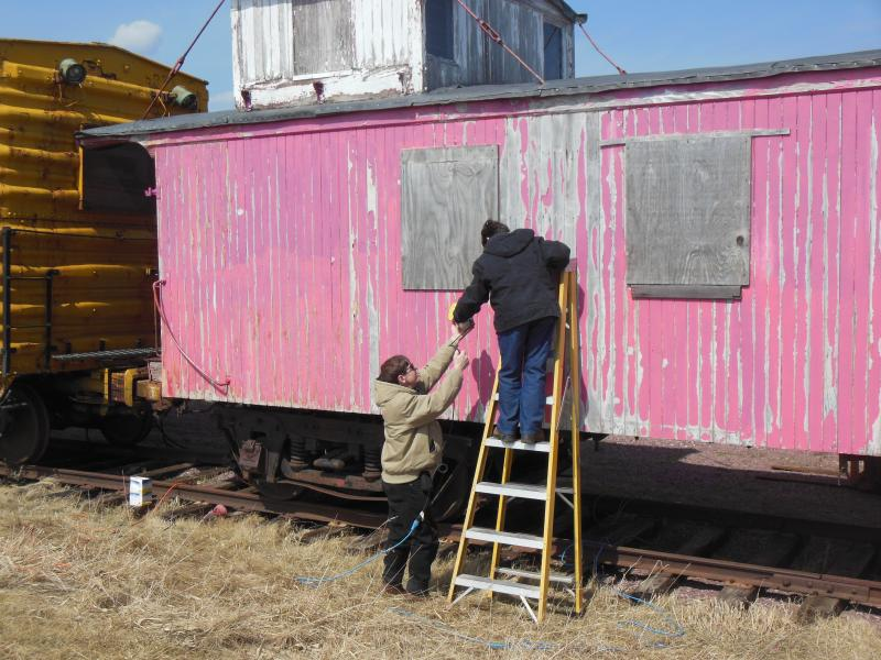 Volunteers Ron & Sue Goedken scrape paint on CB&Q 14534, April 2015
